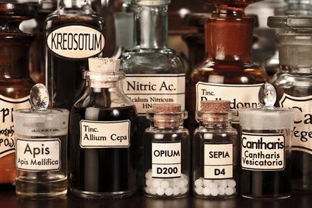 Various pharmacy bottles of homeopathic medicine on dark background