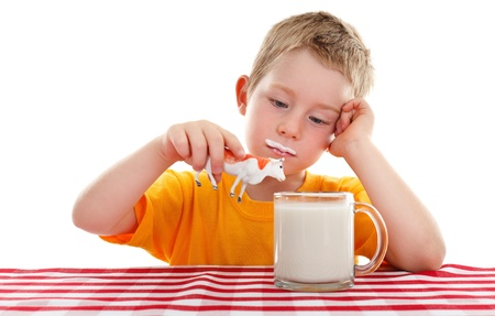 milk mustache: Young kid holding toy cow above big glass cup of milk