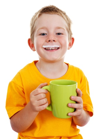 Happy kid with milk mustache holding big green cup in-front of him Stockfoto