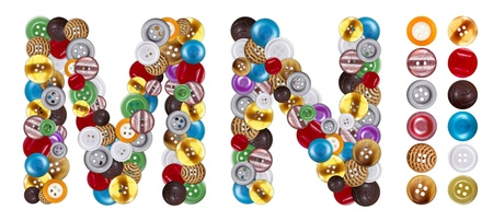 standalone: Characters M and N made of colorful clothing buttons. Standalone design elements attached Stock Photo