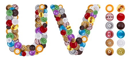 standalone: Characters U and V made of colorful clothing buttons. Standalone design elements attached Stock Photo