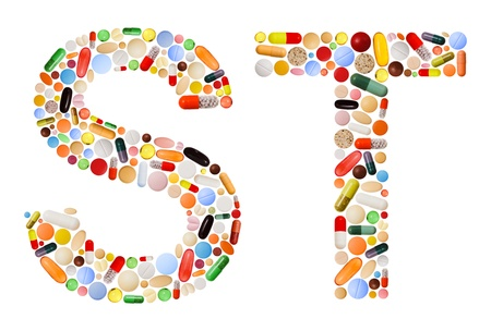 Characters S and T made of various colorful pills, capsules and tablets photo