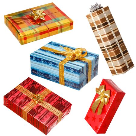 Various gifts isolated on white  Boxes wrapped with colorful paper, bow on each present photo