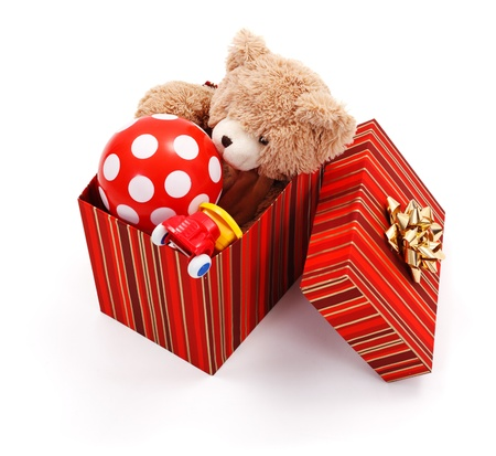 christmas toy: Big wrapped gift box full of various toys Stock Photo
