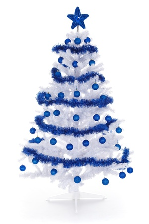 Artificial white christmas tree on white, decorated with blue ornaments and garland