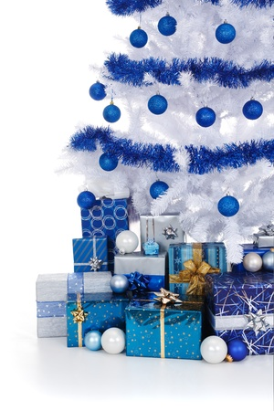 artificial white christmas tree decorated with blue ornaments and garland lots of presents under