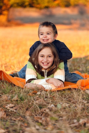 Happy kids playing outdoors in autumn Stock Photo - 13697814