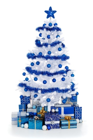 Artificial white christmas tree on white, decorated with blue ornaments and garland, lots of presents under the tree Stockfoto