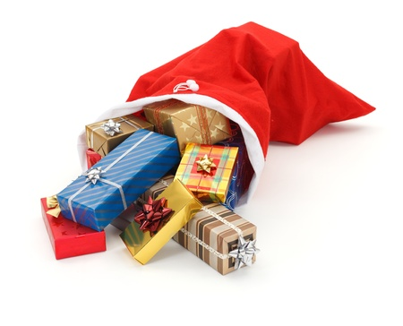 Lots of colorful Christmas presents pouring from Santa bag Stock Photo