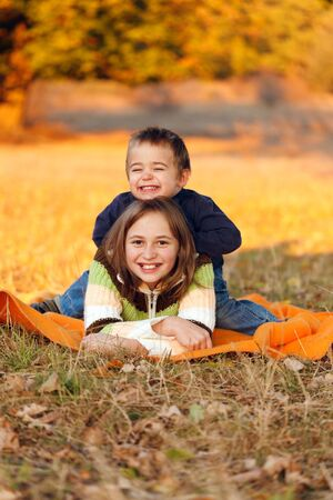 Happy kids playing outdoors in autumn Stock Photo - 13697815
