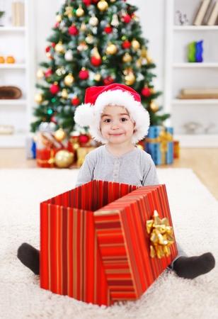 box big: Happy boy sitting behind big open Christmas present box Stock Photo