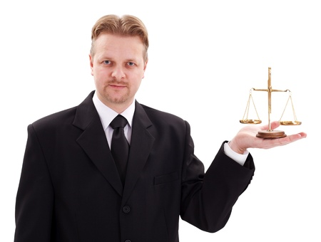 Serious lawyer showing small golden justice scale photo