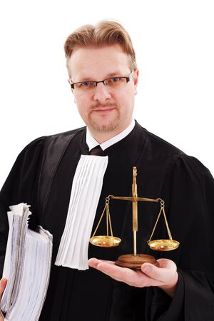 Serious judge holding thick paperwork and  showing justice scale photo