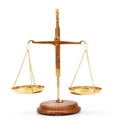 balance scale: Miniature golden scale on white Stock Photo