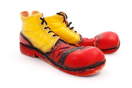 Very big red-yellow clown shoes on white
