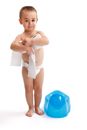 Little boy near blue potty holding toilet paper in his hand photo