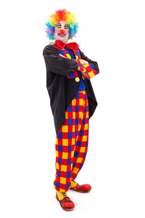Proud clown in colorful wearing, standing with folded arms on white background photo