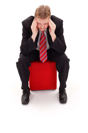 Businessman concentrate, sitting on red tabouret photo