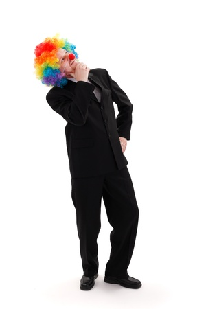 Business man thinking, colorful clown wig on his head photo