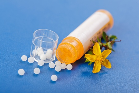 homeopathic: Modern homeopathic pills and real Hypericum flower