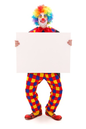 Happy clown in funny posture, holding blank white board photo