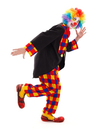 Happy clown standing in a funny posture photo