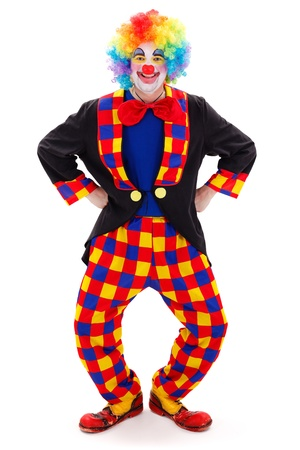 Smiling clown standing in funny posture with hand on his hip