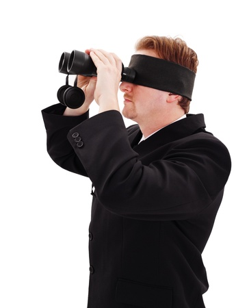 Blindfold bussiness man trying to look through binoculars photo