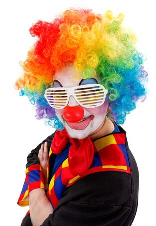 Smiling clown wearing colorful wig and white, funny shutter shades sunglasses  photo