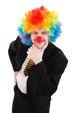 Smiling and thinking business man, wearing colorful clown wig photo
