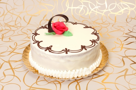 marzipan: White cake with chocolate ornaments and red marzipan rose