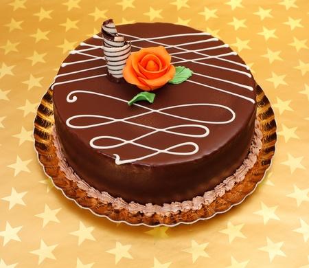 marzipan: Chocolate cake with white chocolate ornaments and orange marzipan rose