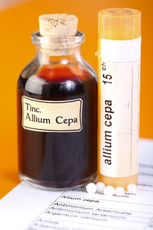 Allium Cepa plant extract  Mother tincture and homeopathic pills on sheet