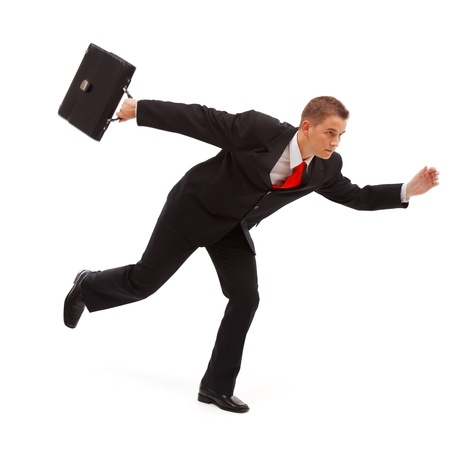 Young businessman running with case photo
