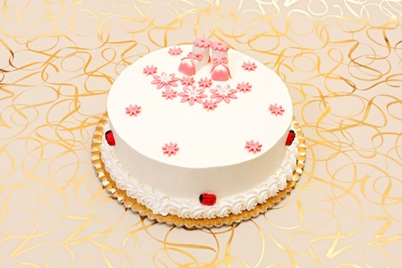 baptist: White baptist cake for girl with pink decoration