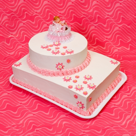 topper: White christening cake for girl with topper and pink decoration
