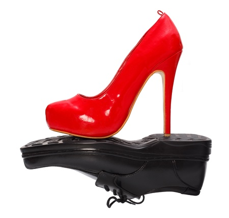 High heel red woman shoe against black man shoe photo