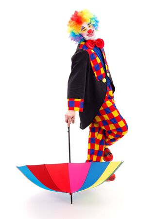 relies: Happy clown relies on colorful umbrella