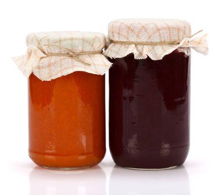 jam jar: Plum and peach jam in glass jar on white background Stock Photo