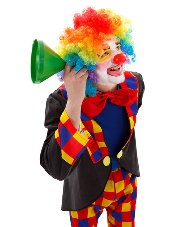 comedic: Smiling clown listening for news with a green funnel Stock Photo