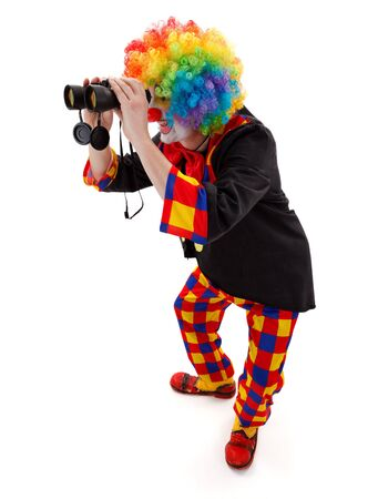 Clown in colorful wig searching; looking through binoculars Stock Photo - 17643818