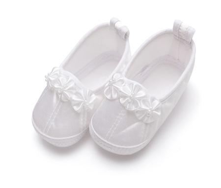 Satin christening newborn shoes on white background photo