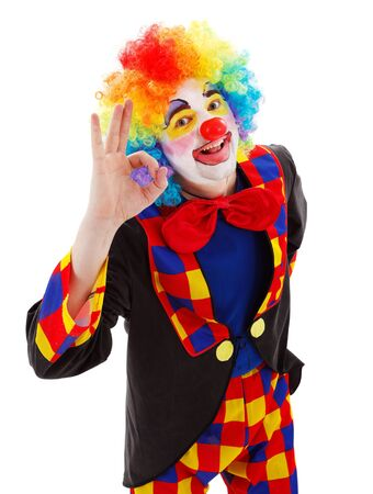Smiling clown showing ok sign with his hand photo