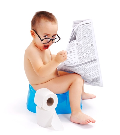 piddle: Little boy sitting on potty, wearing big glasses and holding newspaper