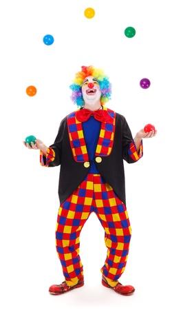 clown cirque: Drôle de clown jonglerie avec balles colorées