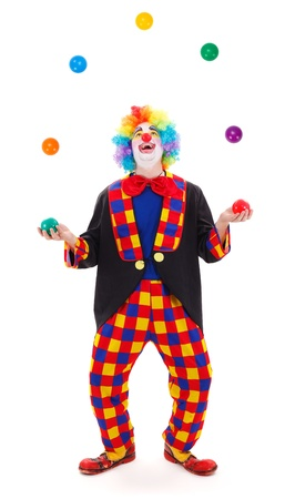 Funny clown juggling with colorful balls