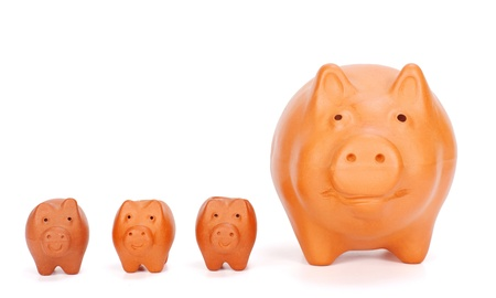 compound: Financial concepts visualized by various sized piggy banks