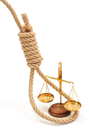 stifle: Miniature golden scale in thick halter. Conceptual view of justice system being strangulated Stock Photo
