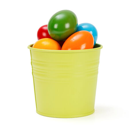 Lots of colorful Easter eggs in green pail photo