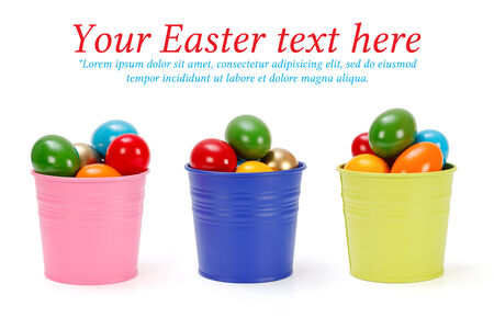 Colorful tin pails with painted Easter eggs photo
